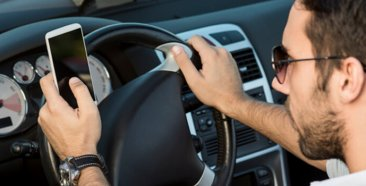 Image of a Distracted Driving: Top 6 Causes
