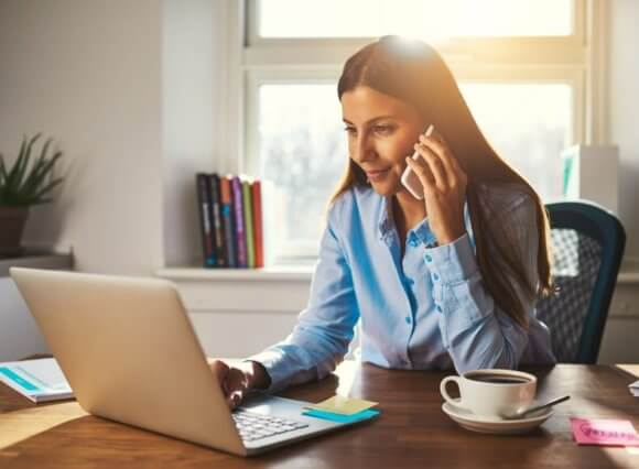women talking on the phone and working from home during coronavirus