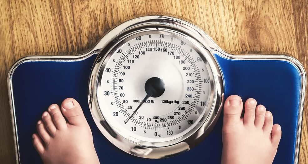 feet on scale measuring weight insurance for obese people
