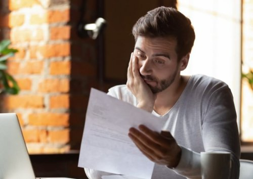 worried young man looking at paper business disruption insurance coronavirus