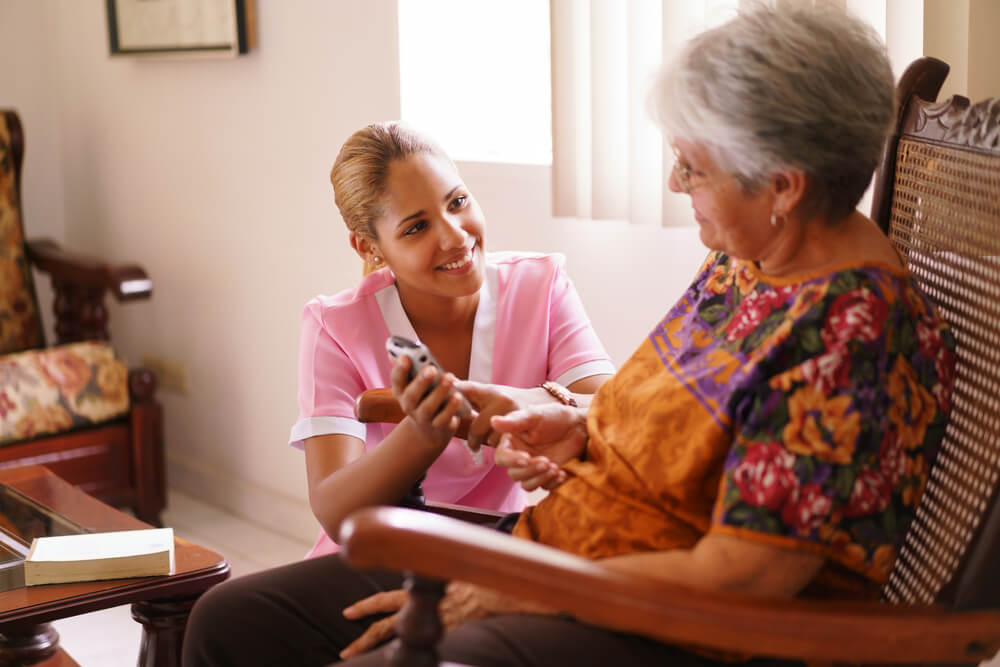 elderly woman with nurse in her house with in home senior care