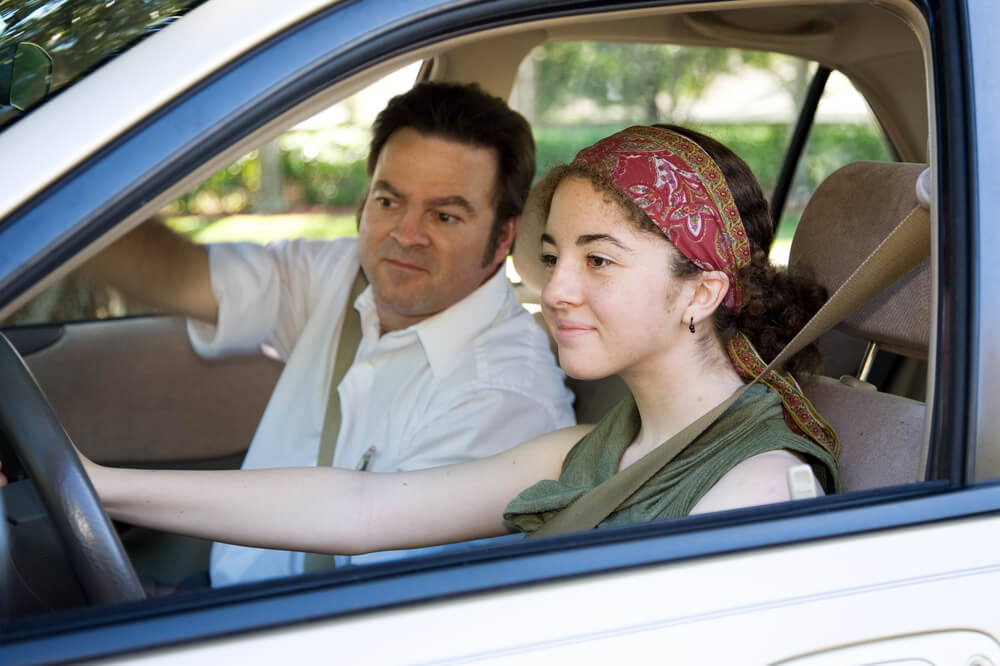 Teen learning to drive or taking driving test with cheap auto insurance