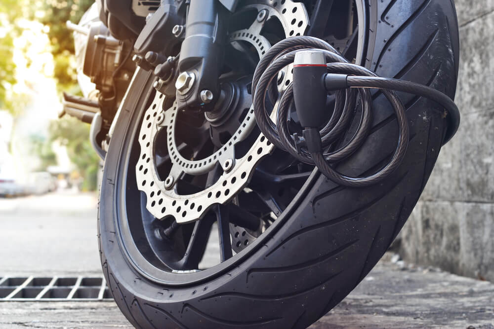 motorcycle with an anti theft lock installed on wheel