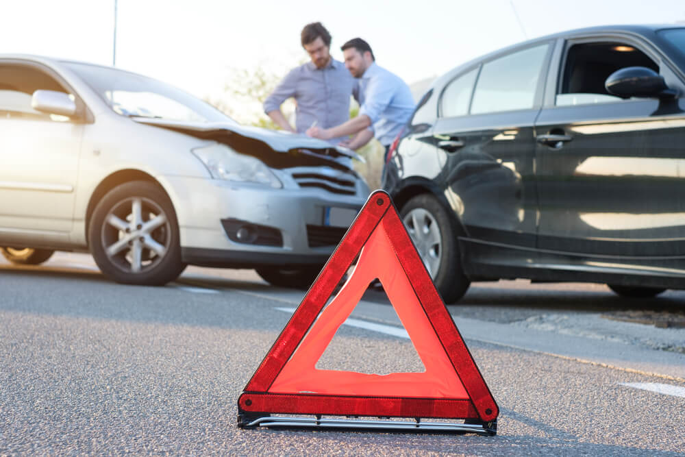 an emergency cone in front of a underinsured motorist car accident