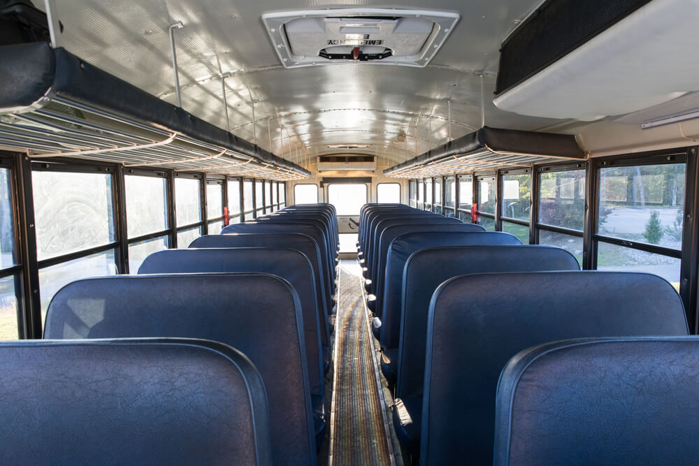 inside view of a school bus about to be converted to a home