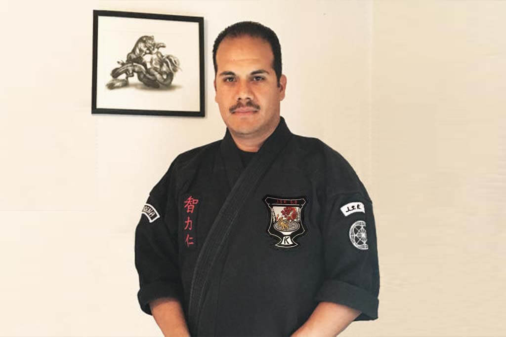 front view of smiling man with martial arts uniform