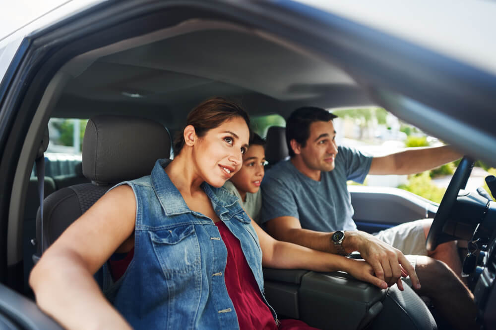 family riding in car with comprehensive insurance in california
