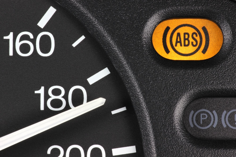 closeup of a car dashboard with antilock brake system auto safety feature