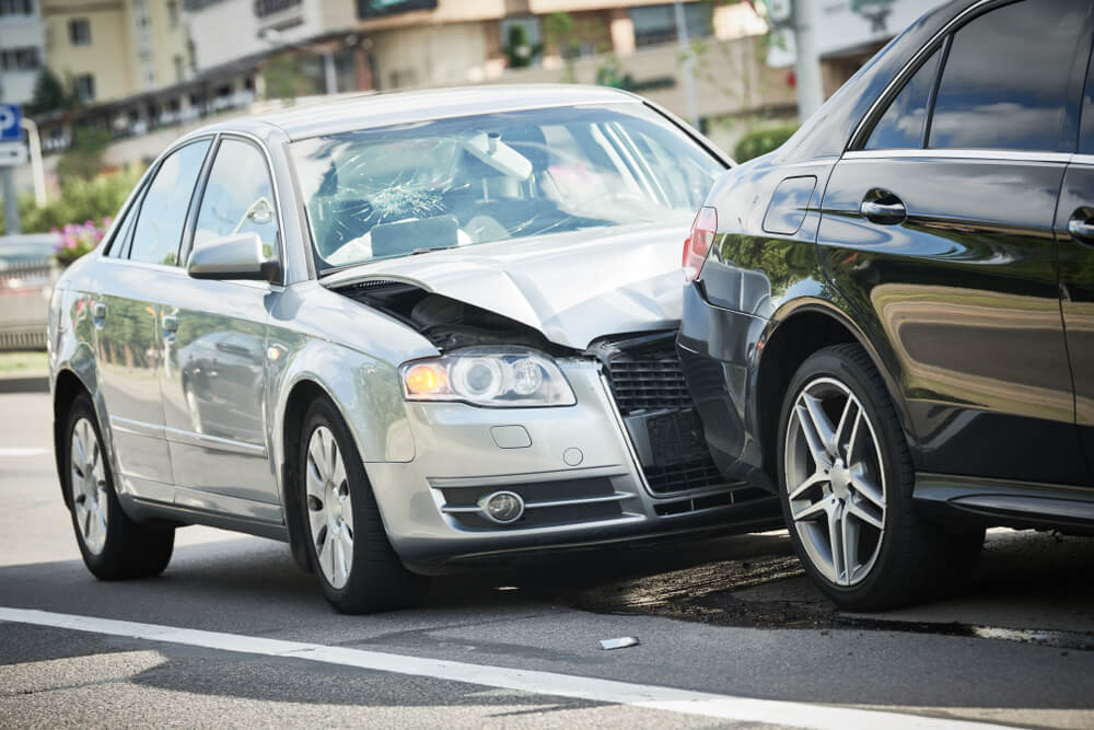 car crash accident on street with car insurance