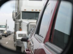 18-wheeler image captured ominiously in the driver's side mirror
