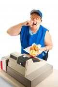 fast food worker sneezing on a meal.