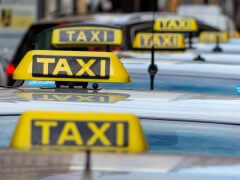 taxis wait at a taxi rank, symbolic photo for passenger transport and service