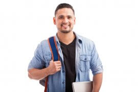 Photo of Hispanic guy going to college carrying a backpack and a laptop computer