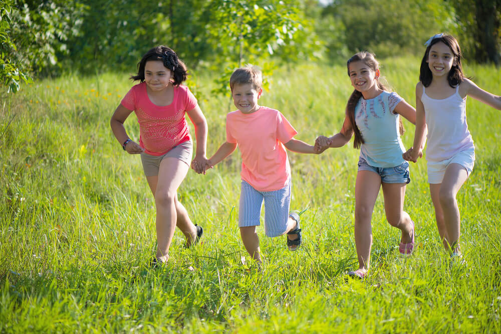 Group of happy children playing at summer camp