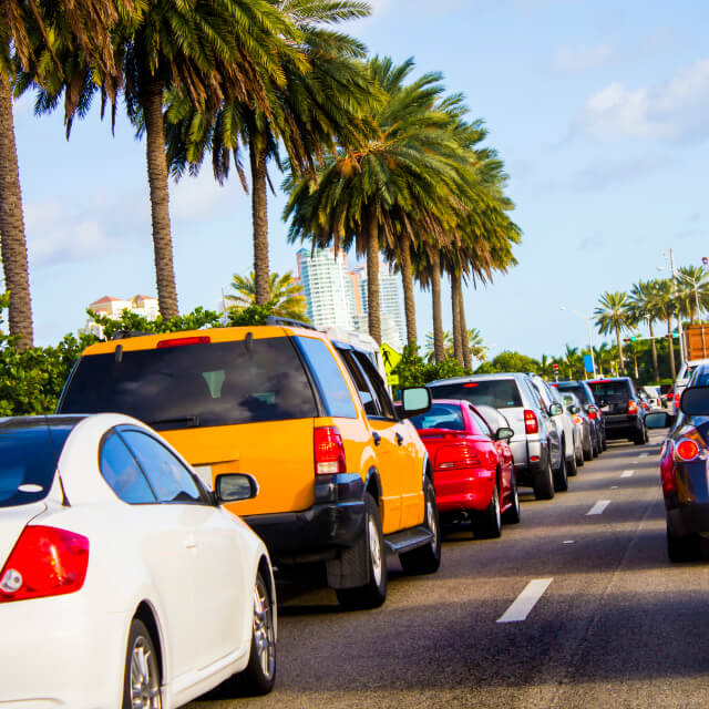 Photo of a road to Miami Beach, Florida with dozens of cars stuck in traffic.