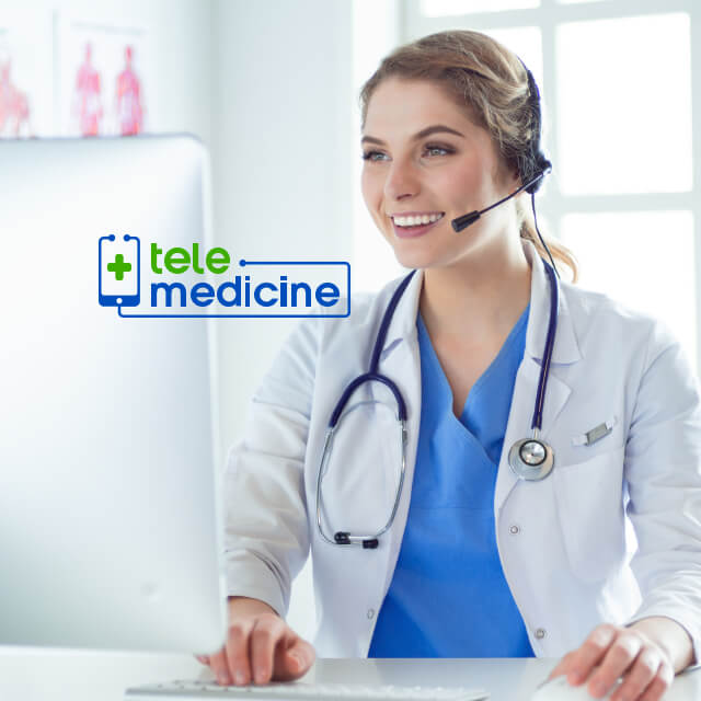 A doctor wearing a stethoscope uses a headset to communicate over a the internet.