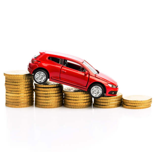 Miniature car driving down a set of decreasing stacks of coins.