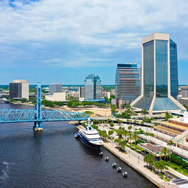 Aerial view of downtown Jacksonville skyline with bridge and river