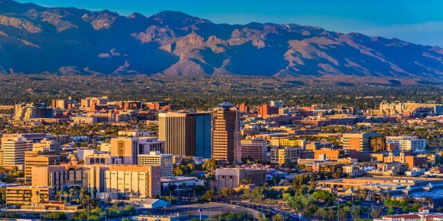 Tucson Arizona skyline and Santa Catalina Mountains at dusk.
